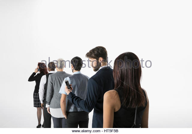 Businessman using with cell phone, waiting in queue against white background - Stock-Bilder