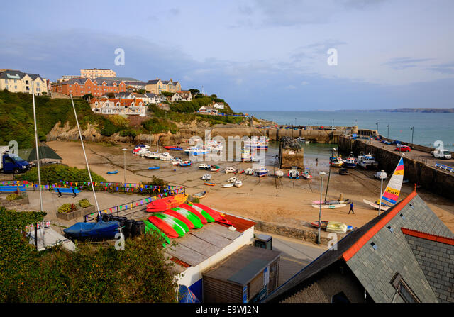 Newquay harbour colourful boats North Cornwall England UK sandy beach - Stock Image