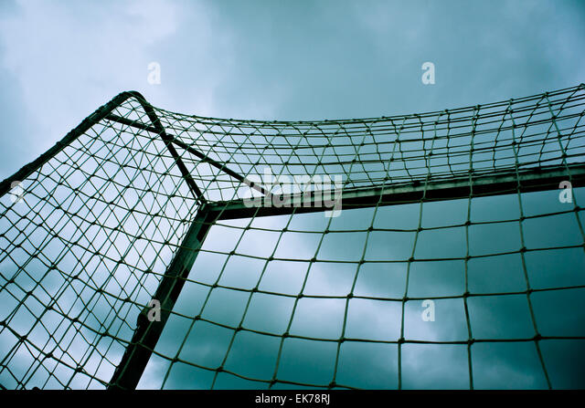 soccer goal with dramatic sky - Stock-Bilder