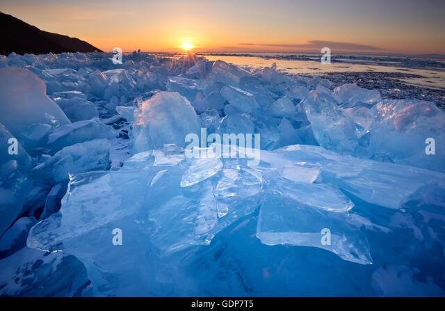 Stacked broken ice at sunset, Baikal Lake, Olkhon Island, Siberia, Russia - Stock Image