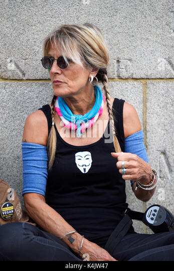 Animal rights activist starting a protest march to promote the vegan lifestyle. Hyde Park, London. Hippy style female - Stock Image