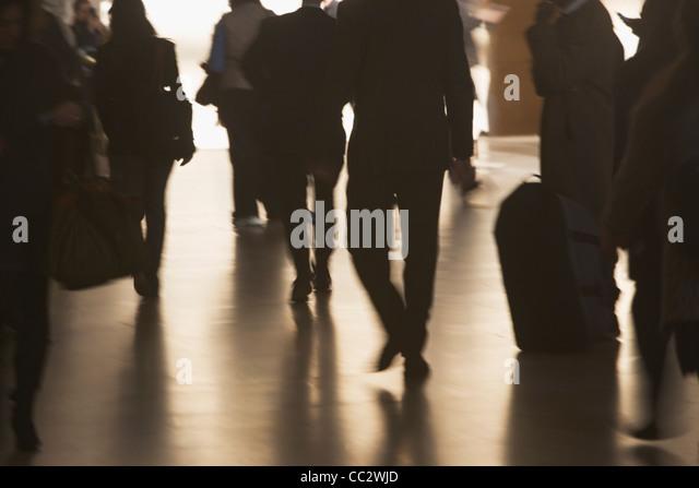 USA, New York City, Urban scene with backlit pedestrians - Stock Image