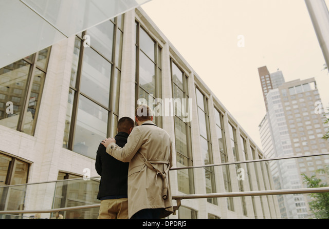 Gay couple looking at building, Lincoln Center, Manhattan, New York - Stock Image