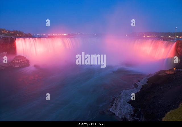 Horseshoe Falls along the Niagara River at dusk during the nightly illumination, Niagara Falls, Ontario, Canada - Stock Image