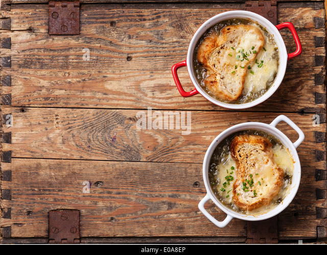 Onion soup with dried bread and cheddar cheese - Stock Image