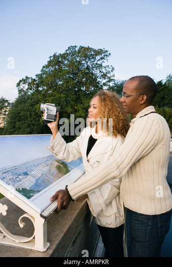 African couple pointing - Stock-Bilder