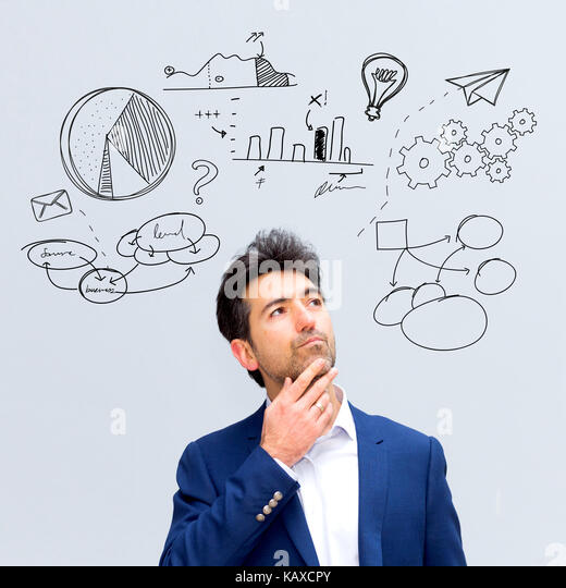 Portrait view of an attractive dubious business man with business icons surrounding his head - Business concept - Stock Image