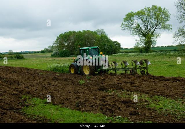 Tractor ploughing field - Stock-Bilder
