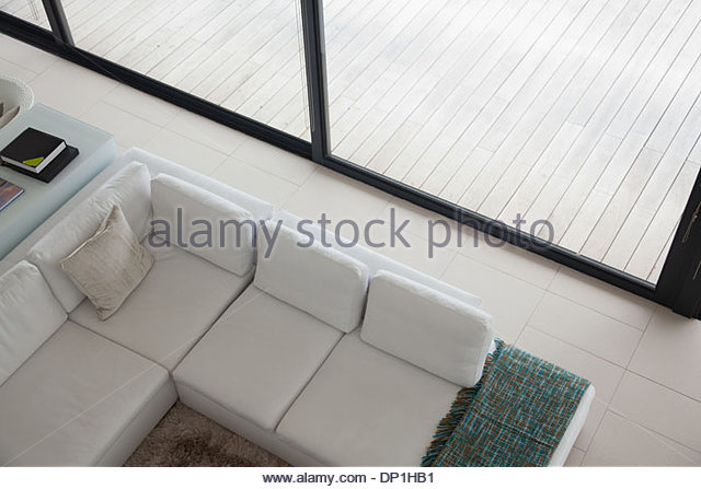High angle view of sectional sofa in modern living room - Stock Image