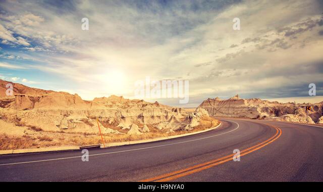 Vintage toned desert road just before sunset, travel concept, USA. - Stock-Bilder