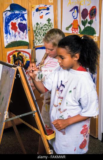 Child's drawing 8-9 year old girls painting artwork in classroom MR ©Myrleen Pearson - Stock-Bilder