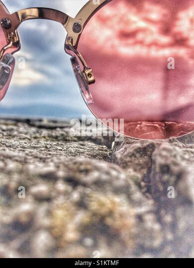 World is pinker through sunglasses - Stock Image