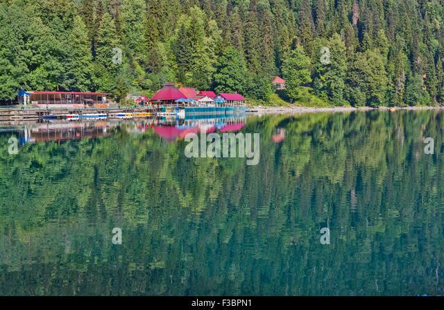 Scenery view of colorful mountain lake with crystal water and beautful reflections Ritsa lake Abkhazia - Stock Image