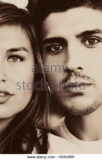 Cropped closeup of a couple's faces - Stock Image