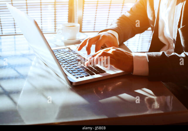 business travel, working on computer laptop online, closeup of hands of businessman, person using wifi internet - Stock Image