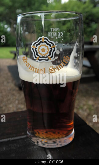 Glass Half Full,Samuel Smith pint glass, Vine Inn, Dunham, Altrincham,Cheshire,England,UK - Stock Image
