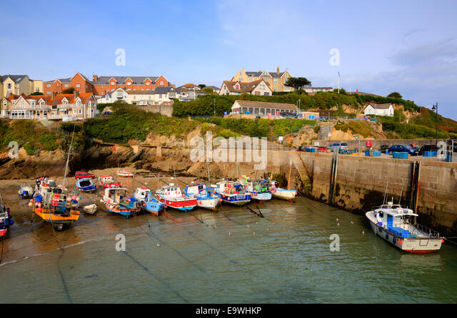 Newquay harbour North Cornwall England UK with boats and sea wall - Stock Image