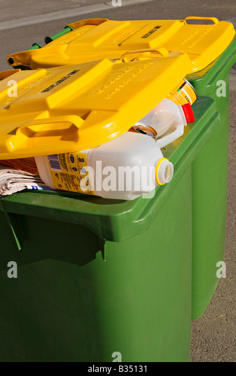 Waste Management / Two Waste Recycle bins stand ready for collection. - Stock Image