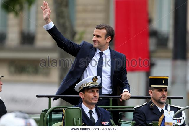 Paris, France. 14th May, 2017. French President Emmanuel Macron waves under the rain as he parades in a car on the - Stock Image