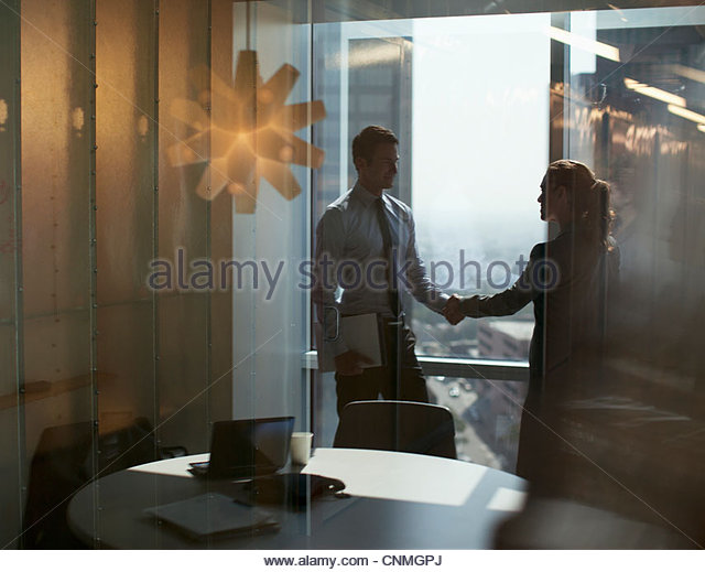 Business people shaking hands in office - Stock-Bilder
