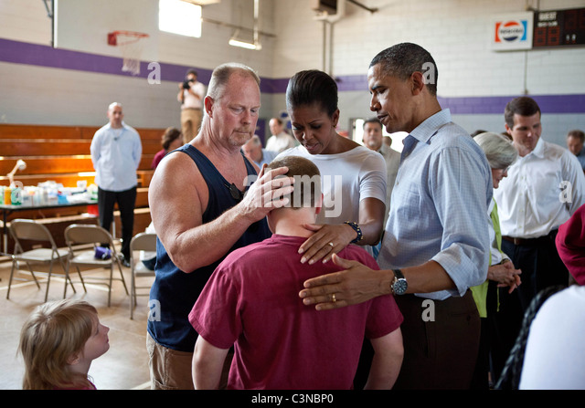President Barack Obama and First Lady Michelle Obama comfort people at Holt Elementary School in Holt, AL, USA - Stock Image