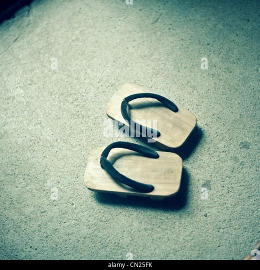 Traditional Japanese wooden flip flops - Stock Image
