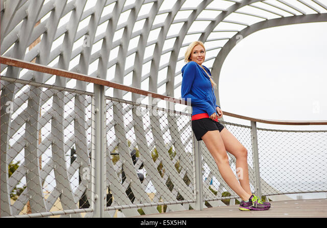 Woman resting against fence, Tongva Park, Santa Monica, California, USA - Stock Image