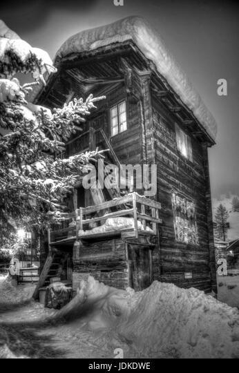 Wooden hut in Old Zermatt at Dusk - Stock-Bilder