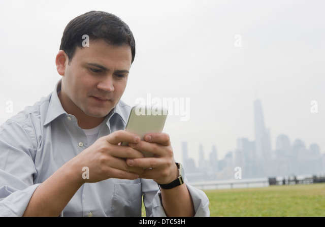 Businessman using cellular phone, Hoboken, New Jersey, USA - Stock-Bilder