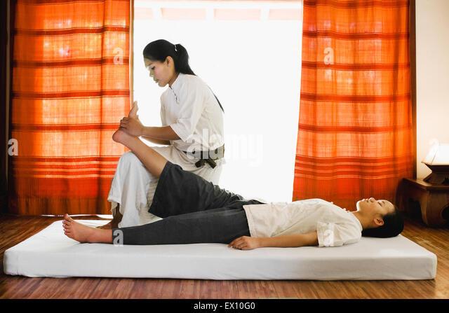 Sip Sen, or traditional Lao Massage at The Spa at La Residence Phou Vao, Luang Prabang, Laos. - Stock-Bilder