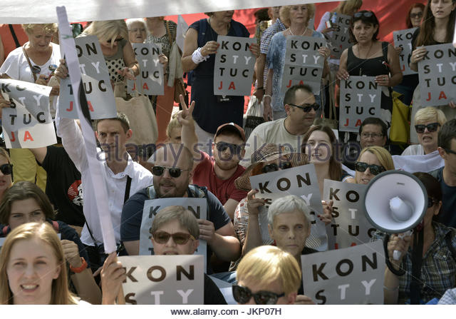 Warsaw, Poland. 24th July, 2017. Protesters hold signs reading 'constitution' (konstytucja' in Polish) - Stock Image