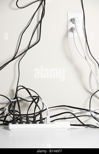 Electrical plugs in a extension cord - Stock Image