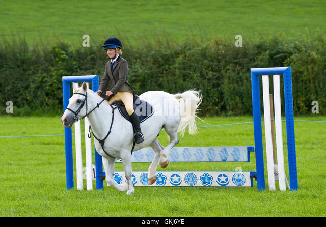 Teenage girl show jumping on her pony at Llanigon YFC Show 2016 nr Hay-on-Wye Powys Wales UK - Stock Image