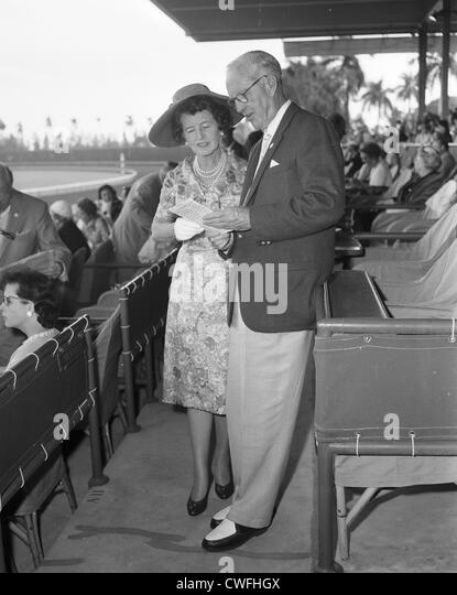Rose Kennedy and Joseph P Kennedy looking at a racing bill at the Hialeah Race Course, Hialeah, Florida, ca 1954 - Stock Image