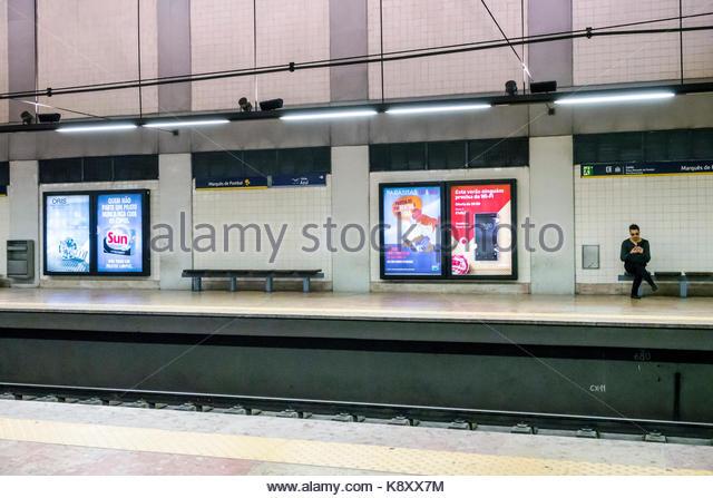 Portugal Lisbon Praca Marques de Pombal Metro Lisboa subway station public transportation platform ads advertising - Stock Image