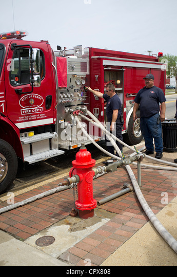 Firemen pressure testing their hoses Perry Fire Dept northwest Florida USA - Stock Image