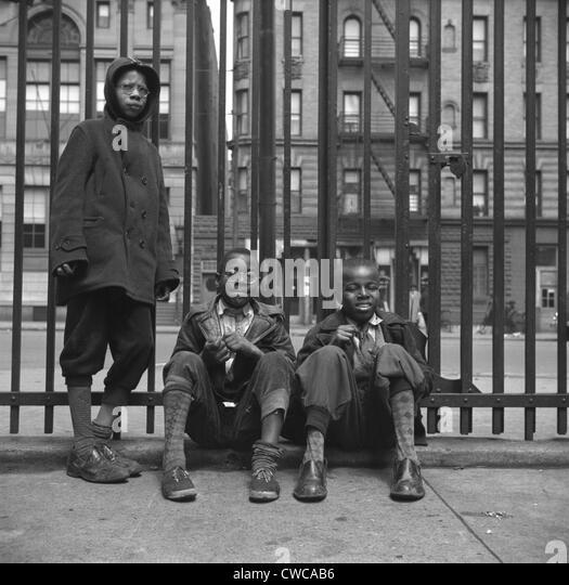 Three African American boys in Harlem. May 1943 photo by Gordon Parks. - Stock-Bilder