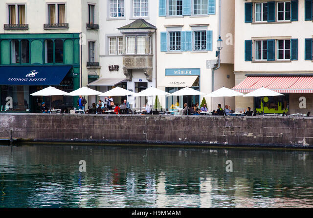 Cafe on the Limmat River in Zurich, Switzerland - Stock Image