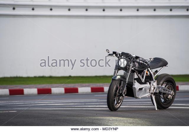 Electric motorbike by royal palace, Bangkok, Thailand - Stock Image