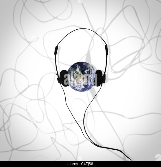 Earth wearing headphones - Stock Image