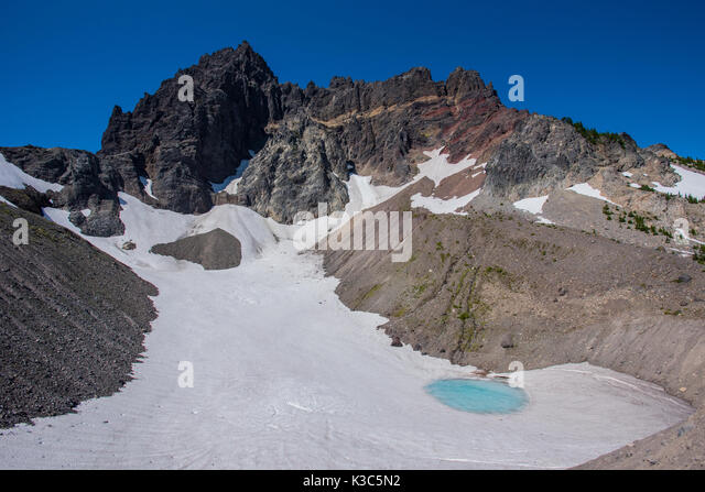 Glacial Tarn Underneath Three Fingered Jack in central Oregon - Stock Image