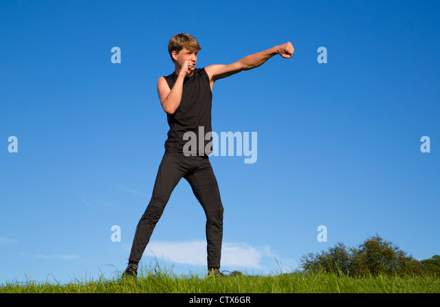 Sportsman is making fighting movements with left hand - Stock Image