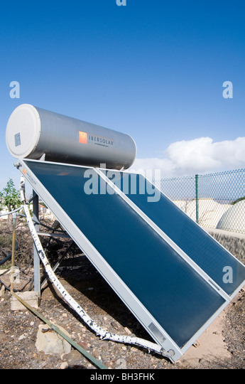 solar panel panels water heating heater heated sun light green energy source sources heaters technology technologies - Stock Image