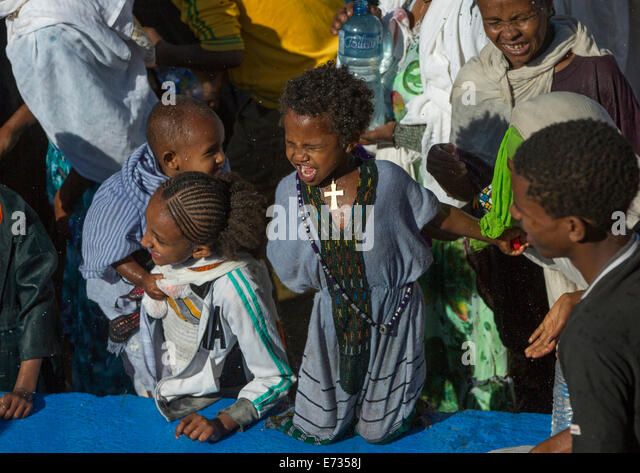 Holy Water Sprayed Onto The Crowd Attending Timkat Celebrations Of Epiphany, Lalibela, Ethiopia - Stock Image