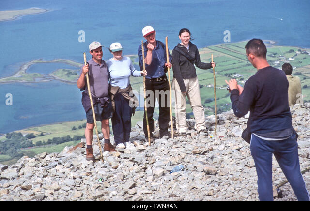 CROGH PATRICK CO MAYO IRELAND, PILGRIMS POSE ON REEK SUNDAY - Stock Image