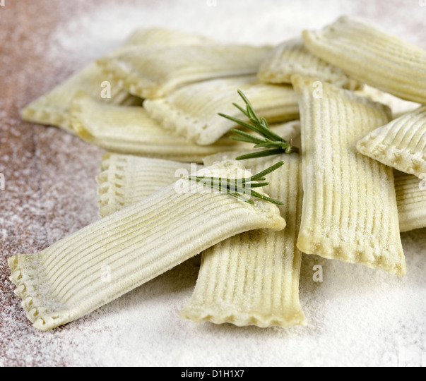Raw And Frozen Pasta Stuffed With Spinach - Stock Image
