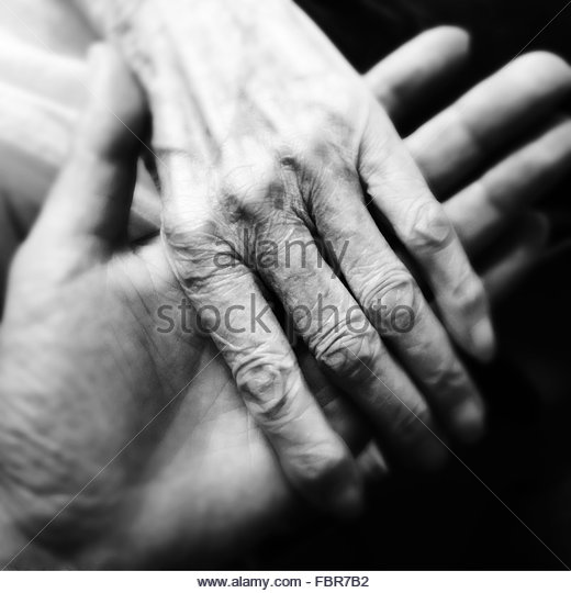 Extreme Close Up Of Couple Holding Hands - Stock-Bilder