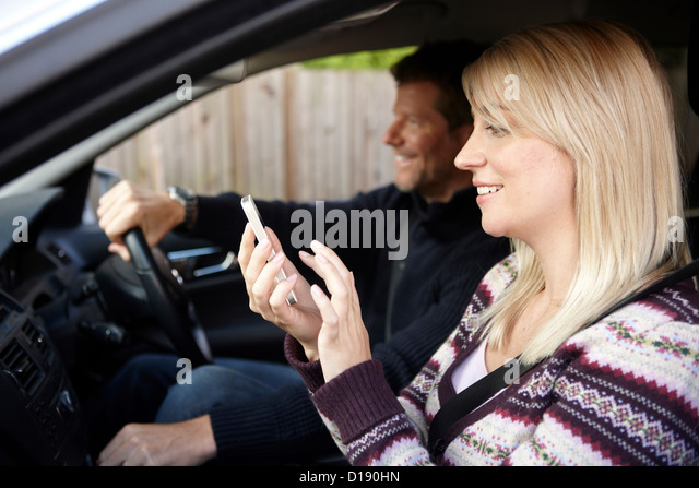 Couple inside car - Stock Image