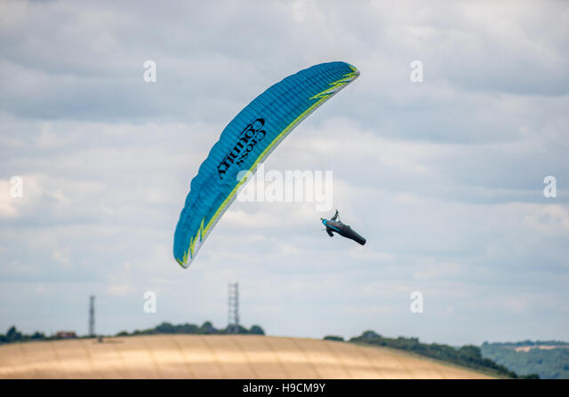 Parascender flying over the South Downs at Devil's Dyke - Stock Image