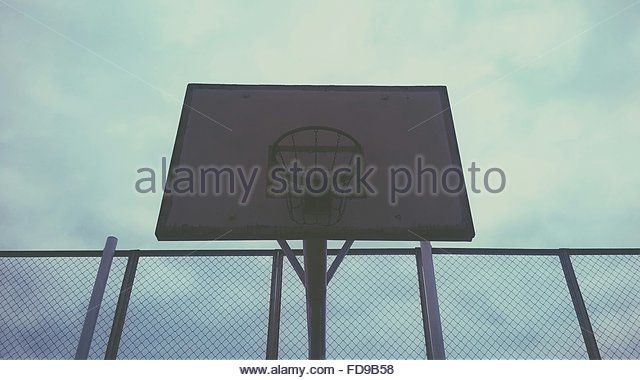 Low Angle View Of Basketball Hoop - Stock Image